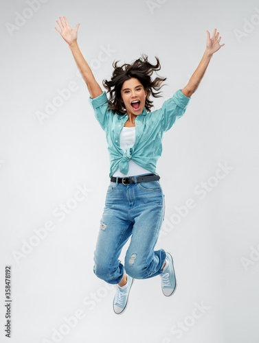 Cuadros en Lienzo people, ethnicity and portrait concept - happy young woman in turquoise shirt an