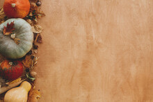 Pumpkins, Autumn Leaves, Corn, Walnuts,chestnuts,acorns Border On Rustic Wooden Table. Flat Lay With Space For Text. Happy Thanksgiving. Autumn Seasonal Harvest. Hello Fall