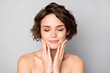 Closeup photo of beautiful nude lady short bob hairstyle enjoy rejuvenation spa salon procedure soft silky facial skin eyes closed touch cheekbones isolated grey color background