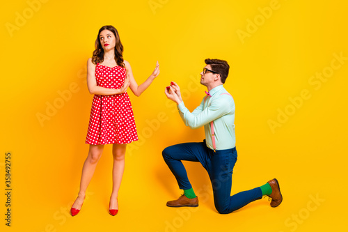 Fotografering Full length photo of frustrated girl reject guy give her jewelry ring propose ma
