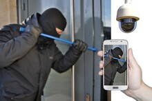 Shot Of A Masked Man Trying To...