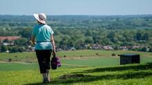 Woman Walking Towards A Large ...
