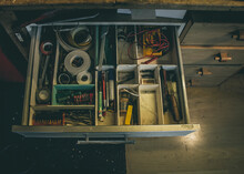 Junk Drawer In A Workshop With...