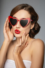Cute Young Woman Wearing Funny Red Sunglasses