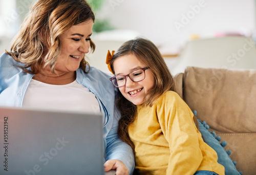 Fotografie, Tablou laptop computer education mother children daughter girl familiy childhood home c