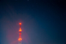 Radio Tower On Night Starry Sky Background