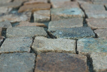 Unique Background Of Very Old Red And Brown Colored Brick Pavers. Close Up, Ground View
