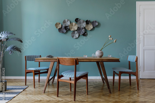 Fototapeta Modern and stylish dining room interior with glamour wooden table , elegant chairs and design decoration. Template. Home decor.  Minimalistic concept of interior design. obraz