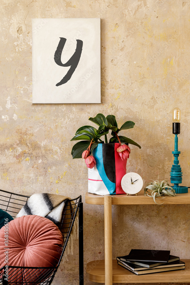 Fototapeta Stylish composition of sitting room interior with mock up photo frame, wooden console, design armchair, plants in hipster pot, decoration, book, table lamp and personal accessories.