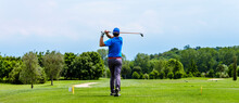Close Up Golfer Is Driving Golf Ball To Green Course