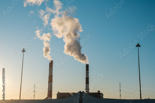 Fototapeta thick smoke belching from factory chimneys