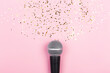 Leinwandbild Motiv ASMR, karaoke, singing, recording concept.  A microphone on blue background and spilling out gold confetti. Voice and sound magic. Minimal compostion.