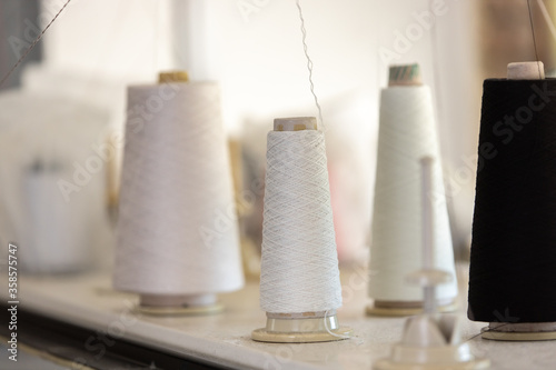 Photo Spools of thread in the sewing equipment in fabric industry