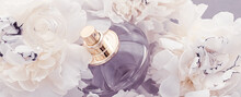 Violet Fragrance Bottle As Luxury Perfume Product On Background Of Peony Flowers, Parfum Ad And Beauty Branding Design