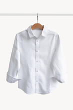 White Shirt Hanging On Shoulders On A White Background