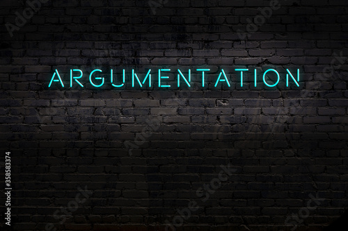 Neon sign. Word argumentation against brick wall. Night view Canvas Print