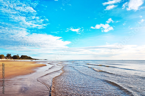 Waves washed ashore with beautiful blue sky background. Canvas Print