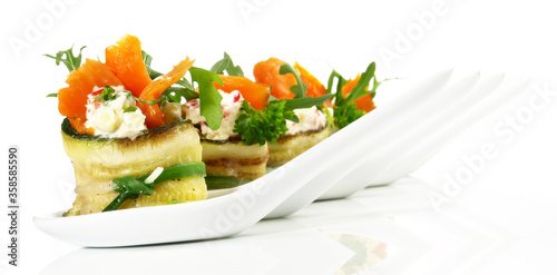 Carta da parati Smoked Salmon on Finger Food Spoons with Vegetables and Salad isolated on white
