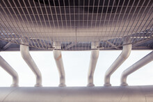 From Below Of Row Of Metal Pipes Of Air Conditioning System Placed Outdoors Of Industrial Complex