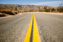 Straight Asphalt Road Going Th...