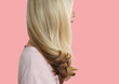 canvas print picture - Senior woman with long blonde hair standing over pink background
