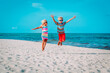 Leinwandbild Motiv happy little boy and girl play on beach, kids enjoy tropical vacation
