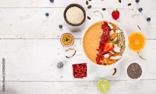 Smoothie bowl with fresh berries, nuts, seeds, fruit and vegetables. Healthy breakfast. - 358626589