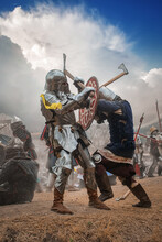 Warriors In Knight Armor Fighting On Battlefield, Reenactment Of Medieval War
