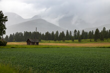 Old Barn In Field With Storm C...