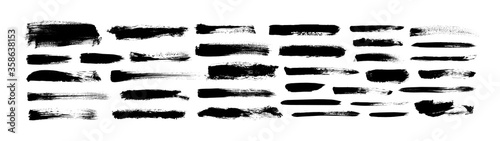 Vector grungy paint brush strokes collection. Calligraphy straight smears, stamp, lines.