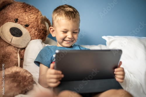 Fotografie, Obraz Little happy child boy using tablet computer