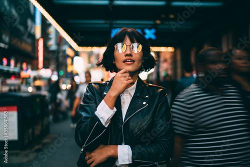 Youthful female traveller in stylish spectacles for vision correction spending t Fototapeta