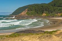 Rolling Waves On A Rocky Coastal Beach