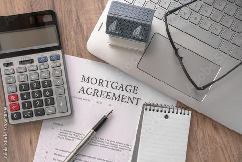 Fototapeta house model with mortgage agreemen obraz