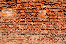 Old Red Brick Wall Background. Traditional Building Exterior. Aged And Grunge Facade.