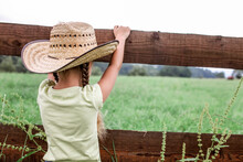 Local Vacation, Stay Safe, Stay Home. Little Girl In Cowboy Hat Playing In Western In The Farm