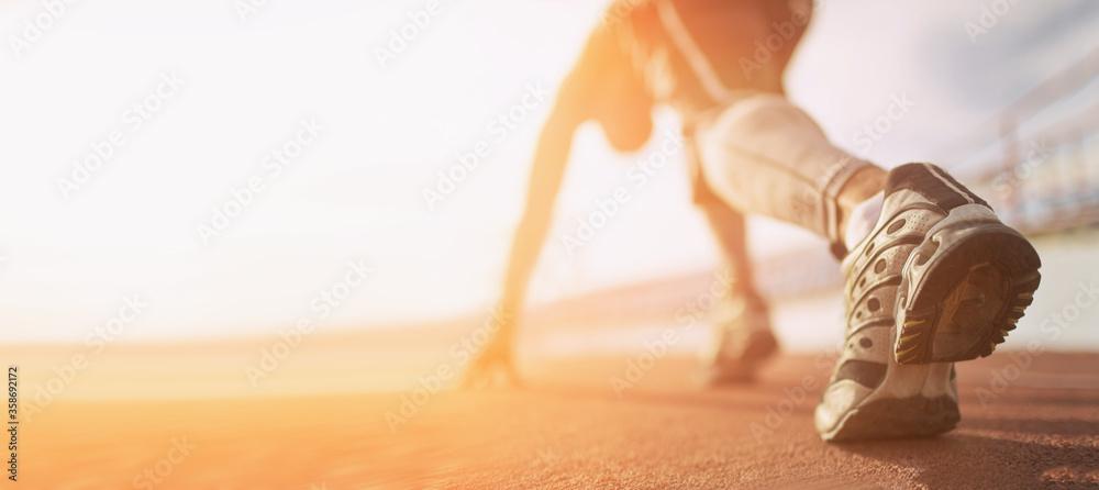 Fototapeta Athlete runner run on start at treadmill