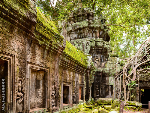 It's Tree roots over the Ta Prohm (Rajavihara), a temple at Angkor, Province, Cambodia Fotobehang