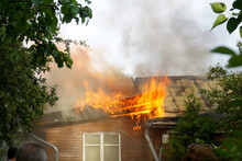 Roof Fire Of An Old Wooden House.