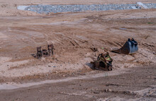 Backhoe Attachments On Ground