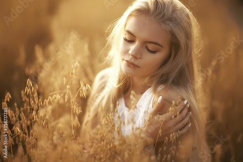 Fotografie, Obraz girl adult in an oat field sexy / happy girl in a summer field, blonde with long