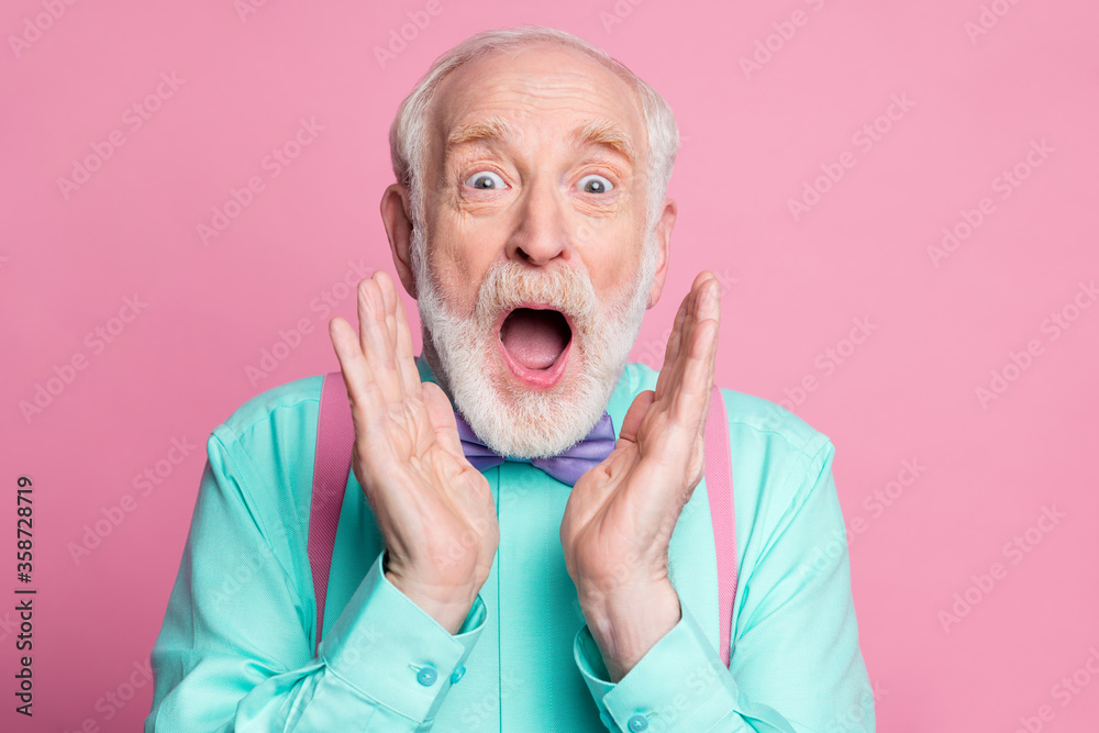 Fototapeta Closeup photo of excited crazy attractive grandpa open mouth listen good news astonished facial expression wear mint shirt suspenders bow tie isolated pink pastel background