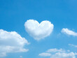 White heart shaped cloud in the blue sky background