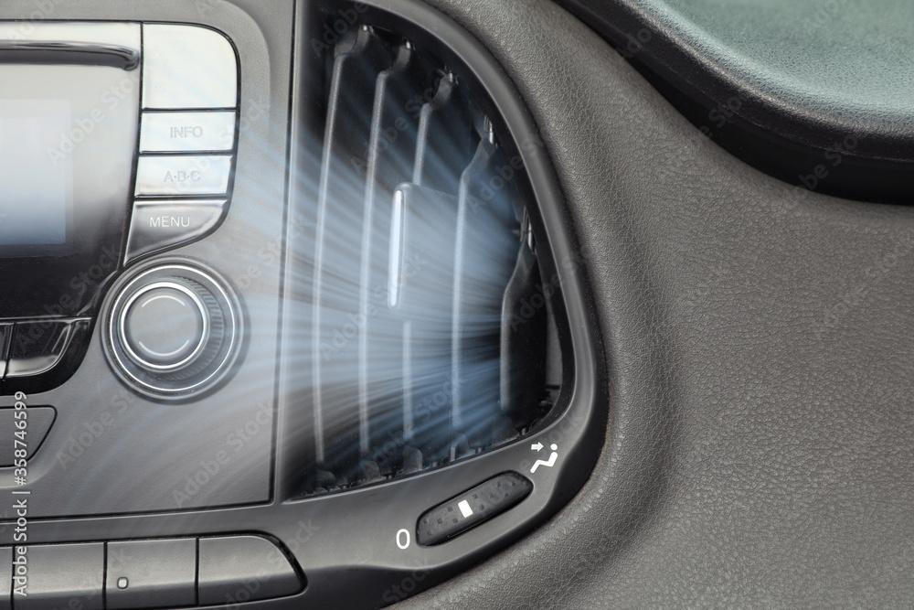Fototapeta Air conditioner system in modern car, closeup
