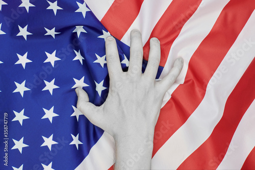 Fotografie, Obraz Colorless hand crumpled national USA american flag