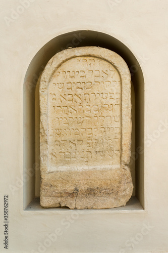 Medieval XIV century Jewish gravestone embedded in the wall of Burg (Graz Castle Canvas Print