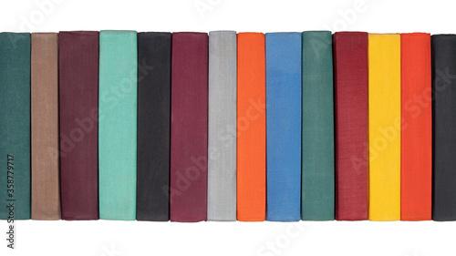 Stack of old hardcover books on bookshelf Fototapet