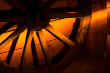 Old Wooden Wheel In The Sunlight