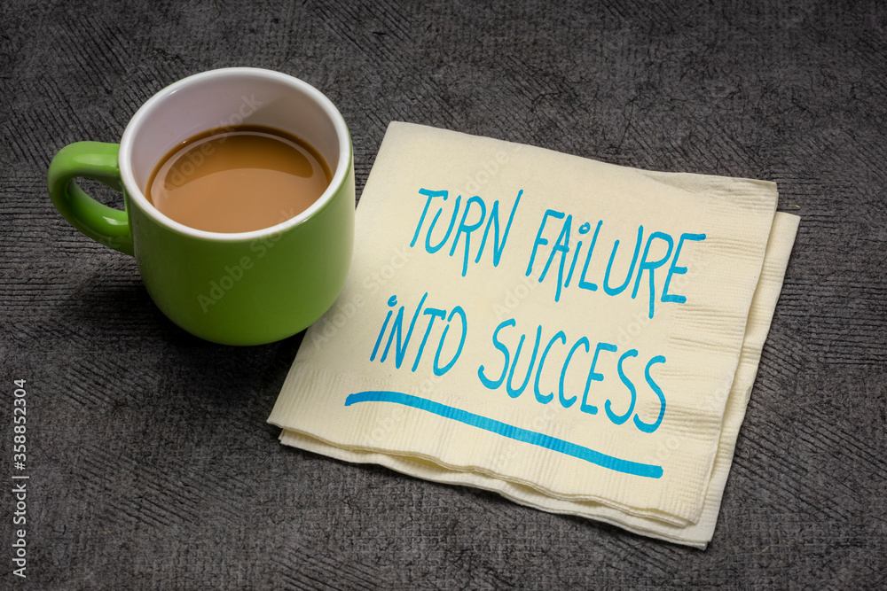 Fototapeta turn failure into success motivational note p handwriting on a napkin with a cup of coffee, business, career, education and personal development concept