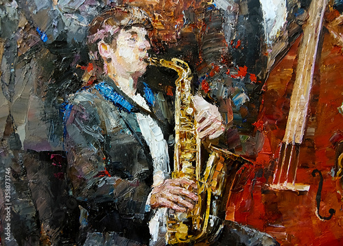 Photo A young musician in a tuxedo playing jazz on the saxophone